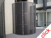 Lift Enclosure: External curved perforated sheetmetal lift screen